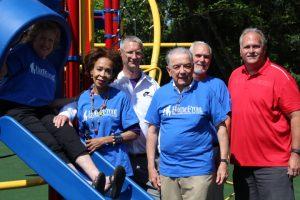 Rotarians at the HomeFront playground ribbon cutting.